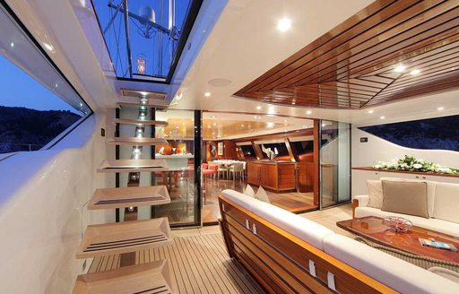 steps leading to sundeck on board luxury yacht prana with alfresco seating area adjacent