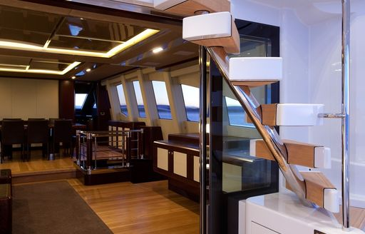 view of staircase and interior dining on board superyacht QUANTUM