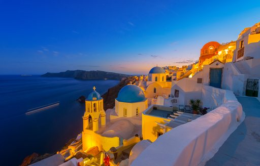 Blue and white buildings of Santorini lit up at nighttime