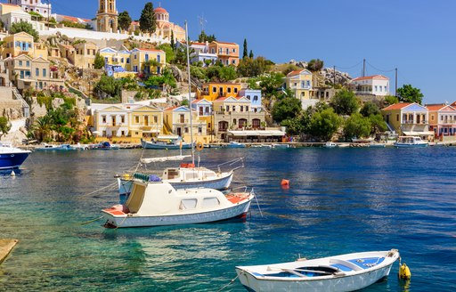 fishing boats on the water in greece
