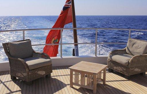 aft deck loungers on board cruising luxury yacht BELUGA