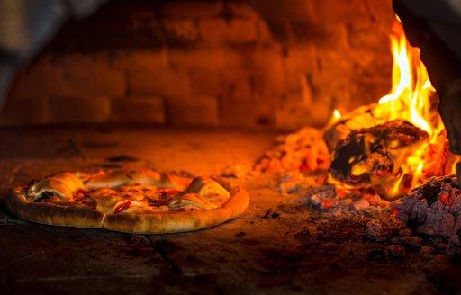 pizza on open hearth on thanda island