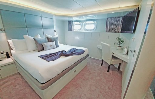 Double bed in cabin on superyacht LIONSHARE
