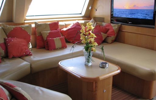 Comfortable seating and tv in main salon of luxury yacht orion