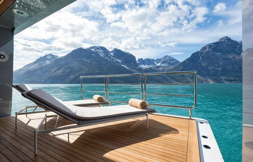 Two sunloungers sat on a retractable balcony integrated into superyacht CLOUDBREAK
