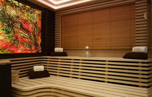 The sauna and rolled up towels on board superyacht KISMET