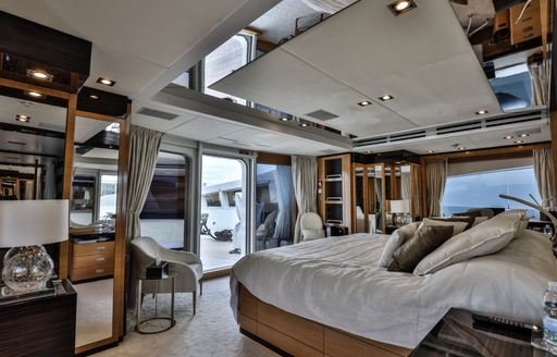 full-beam master suite with neutral colour palette on board charter yacht Africa I