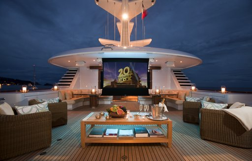 A projector screen shows the 20th century Fox logo on board the sundeck of a superyacht
