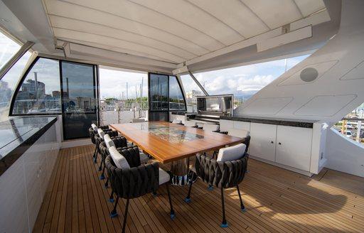 alfresco dining area on sundeck of luxury yacht happy me