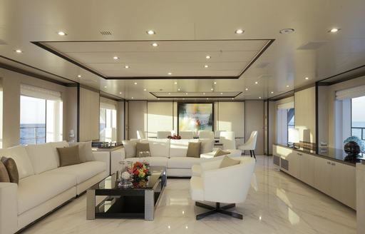 The marble flooring and fresh white sofa seating on board superyacht WILLOW