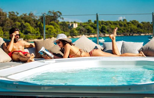 guests enjoy sitting out on private yacht charter