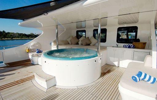 luxury charter yacht tango shaded deck Jacuzzi and sunpads