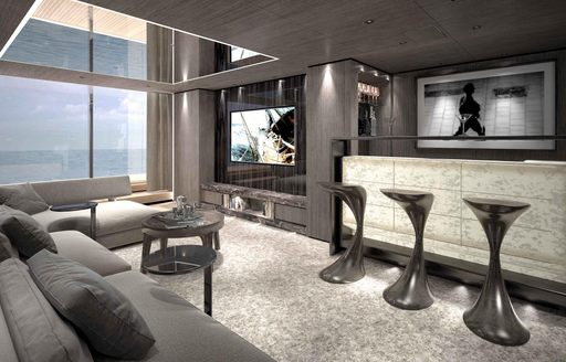 bar and sofa flanked by full-length windows on board superyacht SOLO