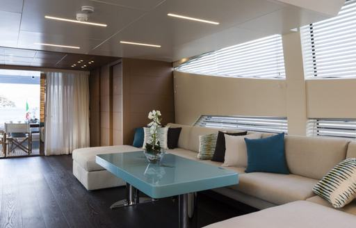 Comfortable sofa and table inside on superyacht 55 FIFTYFIVE