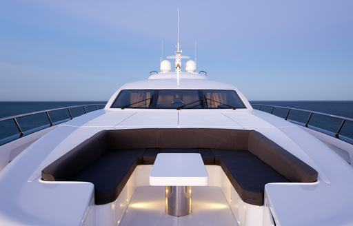 secluded sun pads and seating area on foredeck of motor yacht QUANTUM