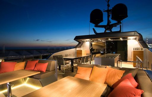 Sundeck of superyacht 4A flydeck lit up at night