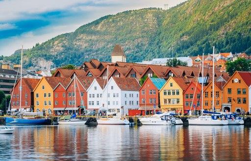 Norwegian houses in pretty harbour in norway