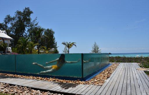 writer katia damborsky in pool on private island thanda island in the indian ocean