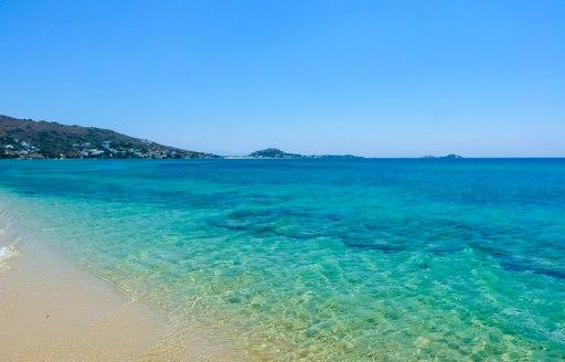 Clear water on plaka beach greece