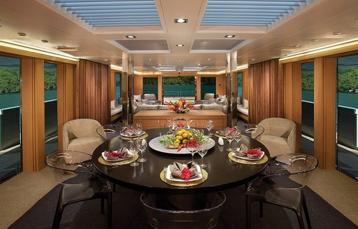 contemporary main salon with rich woods on superyacht 'Big Fish'