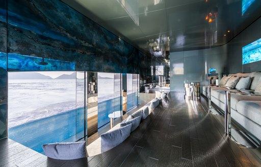 A lounge which looks underwater on board superyacht SAVANNAH