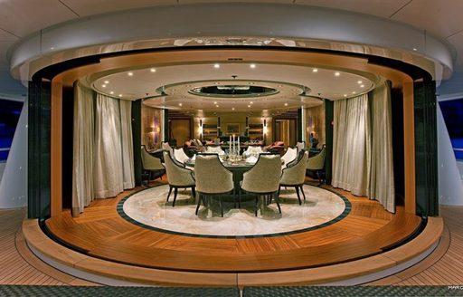 Luxurious skylounge dining on superyacht IMAGINE