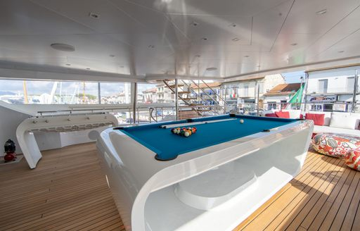pool table on games deck of luxury yacht happy me