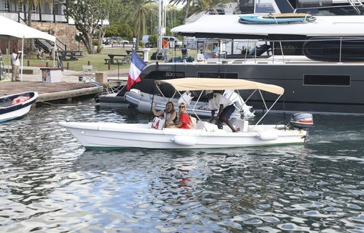tender carrying yacht crew during antigua show