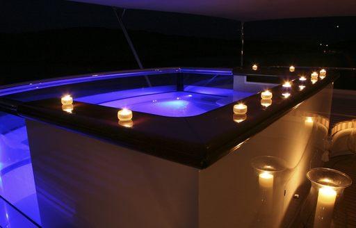 luxury motor yacht PEGASUS deck jacuzzi illuminates beautifully at night