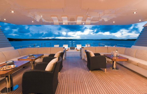 large seating areas under the radar arch on the sundeck of luxury yacht Odessa