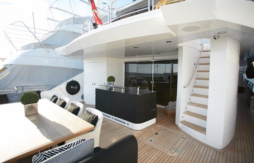No. 9 of London aft deck seating area and wet bar area
