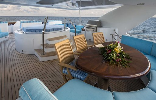 alfresco dining area on the sundeck of motor yacht 'Lady Bee'