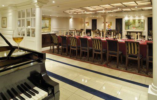Luxury yacht Christina O dining salon with grand piano