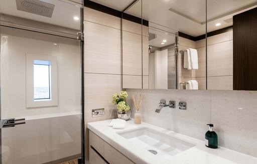 white sink and faucets in the head of luxury yacht jacozami