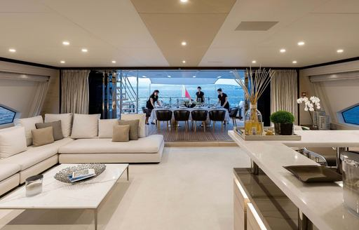 skylounge on luxury charter yacht jacozami,with bar and sofa seating