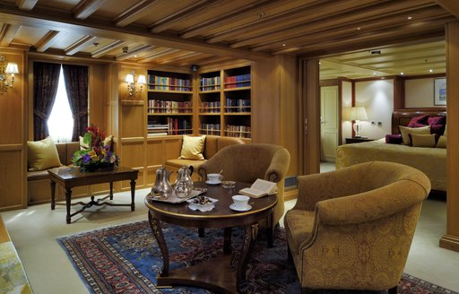 Owner's cabin with sumptuous salon area on Christina O classic yacht