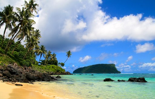 Islands in the south pacific with sandy beach and blue sea