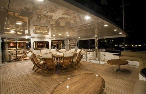 Alfresco dining on the deck of motor yacht MILESTONE