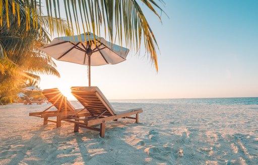 Chairs on the sandy beach near the sea in Bahamas