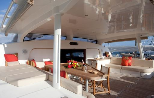 Table and comfortable seating area on deck of superyacht Orion