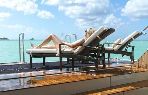 the wellington superyacht beach club with charter guest relaxing
