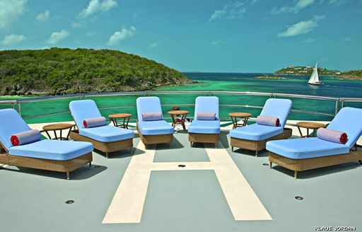 sun loungers lined up on helipad on superyacht 'Northern Star'