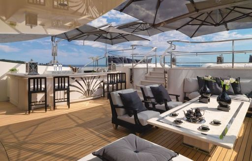 motor yacht silver angel sun deck with dining area, wet bar and jacuzzi pool and shading above