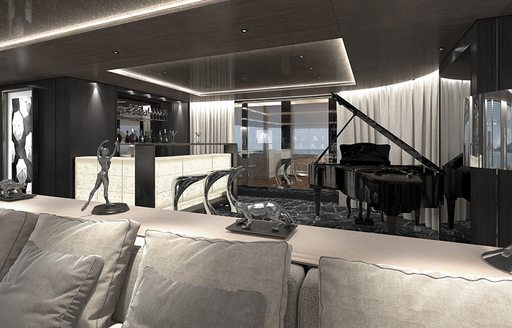 sofa, bar and grand piano in the skylounge aboard superyacht SOLO