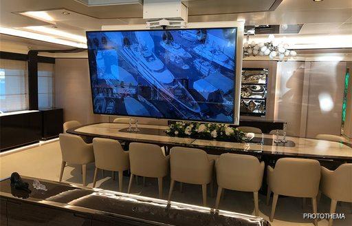 dining salon on luxury yacht opari with tv screen