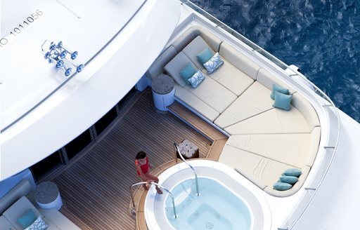A charter guest entering the Jacuzzi on board a superyacht