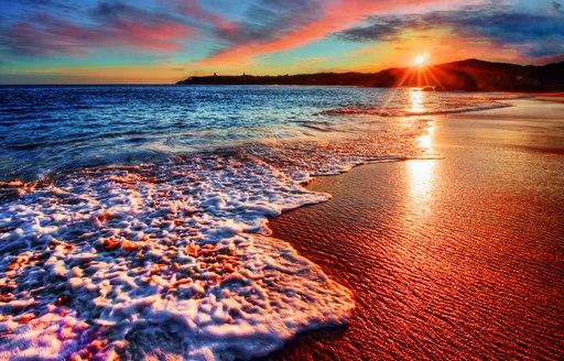 Beach in Mykonos at sunset in Greece