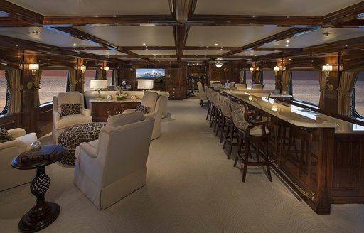 The traditional furnishings and fixtures in the main salon of superyacht Silver Lining