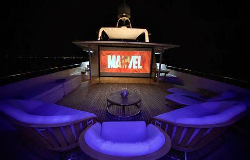 Outdoor cinema at night on superyacht LIONSHARE