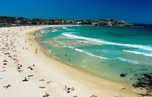 Aerial view of Bondi Beach with blue surf and people sunbathing